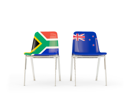 Two chairs with flags of South Africa and new zealand isolated on white. Communicationdialog concept. 3D illustration 版權商用圖片