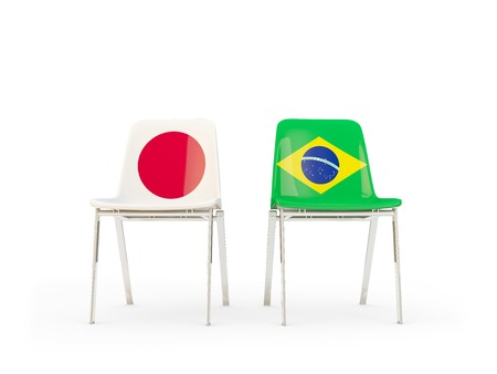 Two chairs with flags of Japan and brazil isolated on white. Communicationdialog concept. 3D illustration