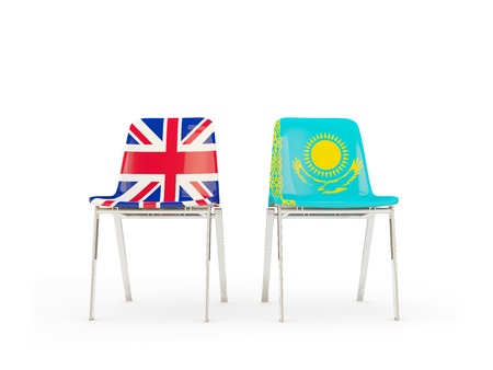 Two chairs with flags of United Kingdom and kazakhstan isolated on white. Communicationdialog concept. 3D illustration