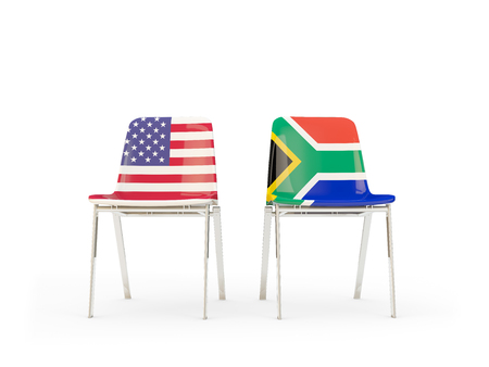 Two chairs with flags of United States and south africa isolated on white. Communicationdialog concept. 3D illustration