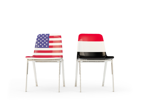 Two chairs with flags of United States and yemen isolated on white. Communicationdialog concept. 3D illustration 版權商用圖片