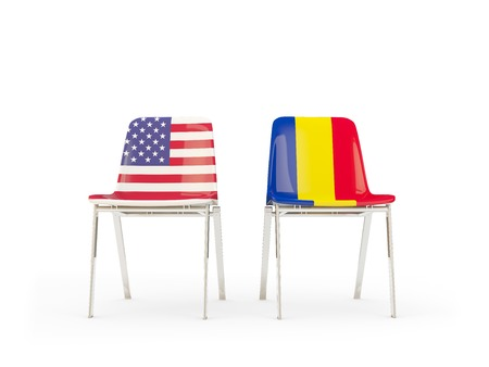 Two chairs with flags of United States and romania isolated on white. Communicationdialog concept. 3D illustration