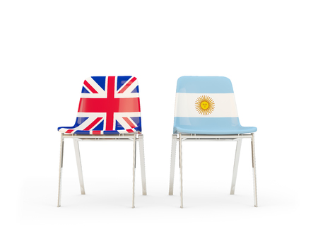 Two chairs with flags of United Kingdom and argentina isolated on white. Communicationdialog concept. 3D illustration 版權商用圖片