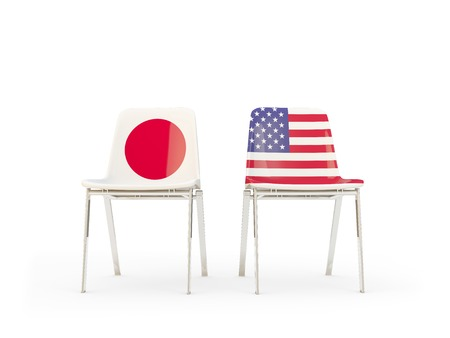 Two chairs with flags of Japan and United States isolated on white. Communicationdialog concept. 3D illustration