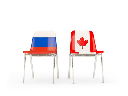 Two chairs with flags of Russia and canada isolated on white. Communicationdialog concept. 3D illustration