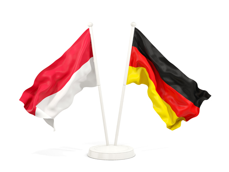 Two waving flags of Indonesia and germany isolated on white. 3D illustration