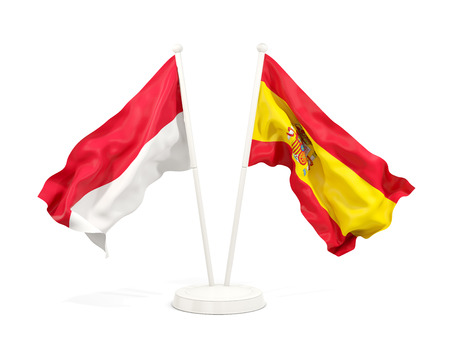Two waving flags of Indonesia and spain isolated on white. 3D illustration