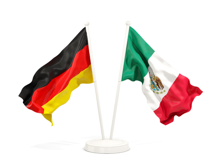 Two waving flags of Germany and mexico isolated on white. 3D illustration Stock Photo