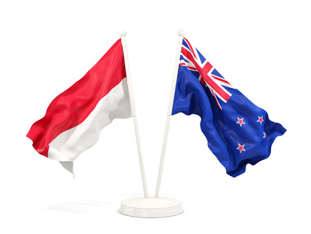 Two waving flags of Indonesia and new zealand isolated on white. 3D illustration Stock Photo