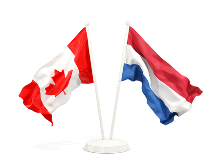 Two waving flags of Canada and netherlands isolated on white. 3D illustration