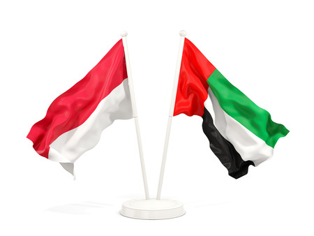 Two waving flags of Indonesia and united arab emirates isolated on white. 3D illustration