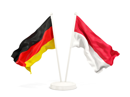 Two waving flags of Germany and indonesia isolated on white. 3D illustration Stock Photo