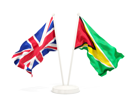 Two waving flags of United Kingdom and guyana isolated on white. 3D illustration Stock Photo