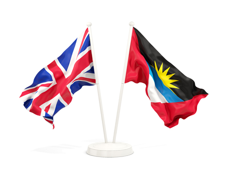 Two waving flags of United Kingdom and antigua and barbuda isolated on white. 3D illustration