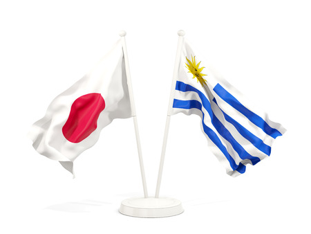 Two waving flags of Japan and uruguay isolated on white. 3D illustration Stock Photo