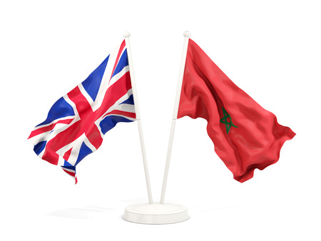 Two waving flags of United Kingdom and morocco isolated on white. 3D illustration