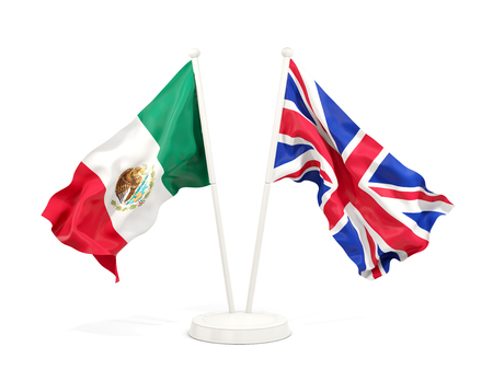 Two waving flags of Mexico and UK isolated on white. 3D illustration