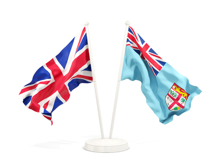 Two waving flags of United Kingdom and fiji isolated on white. 3D illustration Stock Photo
