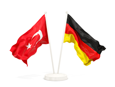 Two waving flags of Turkey and germany isolated on white. 3D illustration