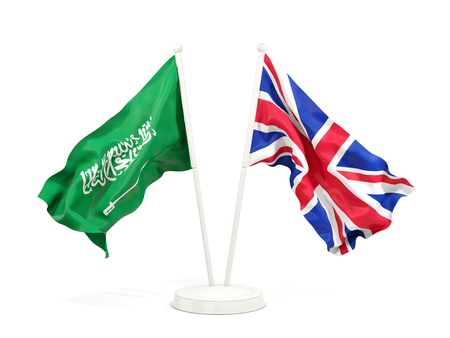 Two waving flags of Saudi Arabia and UK isolated on white. 3D illustration