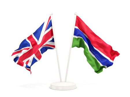 Two waving flags of United Kingdom and gambia isolated on white. 3D illustration