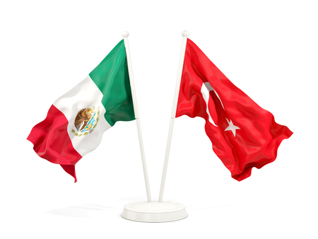 Two waving flags of Mexico and turkey isolated on white. 3D illustration Stock Photo