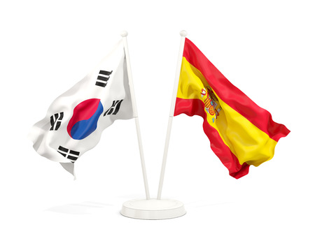 Two waving flags of South Korea and spain isolated on white. 3D illustration