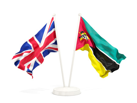 Two waving flags of United Kingdom and mozambique isolated on white. 3D illustration