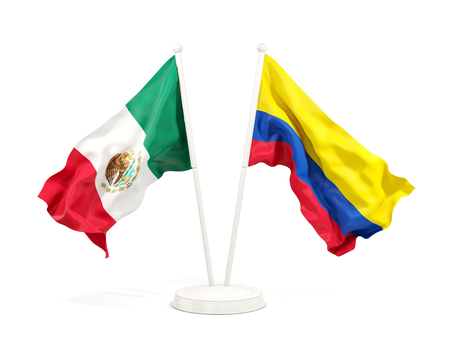 Two waving flags of Mexico and colombia isolated on white. 3D illustration Stock Photo