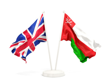 Two waving flags of United Kingdom and oman isolated on white. 3D illustration