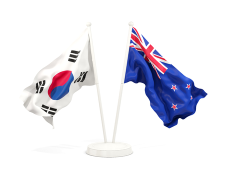 Two waving flags of South Korea and new zealand isolated on white. 3D illustration Stock Photo