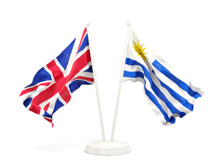 Two waving flags of United Kingdom and uruguay isolated on white. 3D illustration Stock Photo