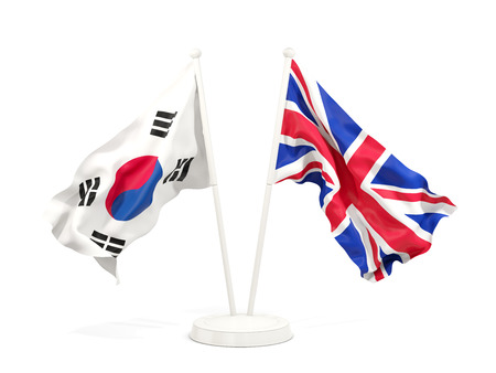 Two waving flags of South Korea and UK isolated on white. 3D illustration