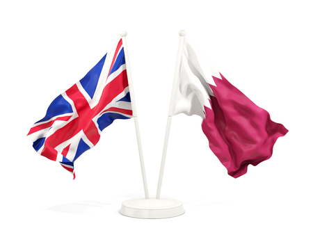 Two waving flags of United Kingdom and qatar isolated on white. 3D illustration