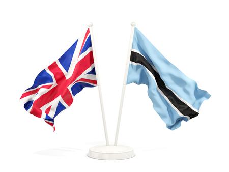 Two waving flags of United Kingdom and botswana isolated on white. 3D illustration Stock Photo