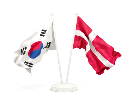 Two waving flags of South Korea and denmark isolated on white. 3D illustration