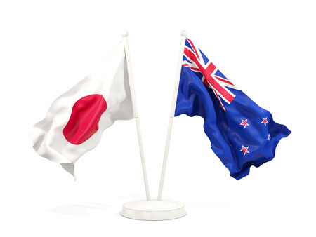 Two waving flags of Japan and new zealand isolated on white. 3D illustration Stock Photo