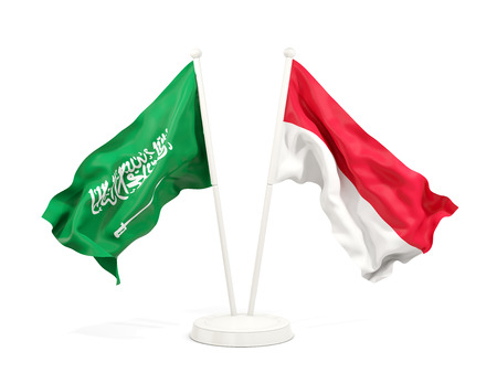 Two waving flags of Saudi Arabia and indonesia isolated on white. 3D illustration Stock Photo