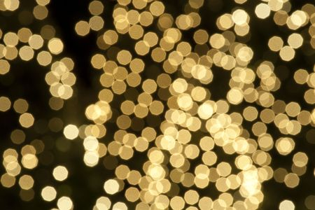 Abstract defocused background of golden sparckly lights Stock fotó