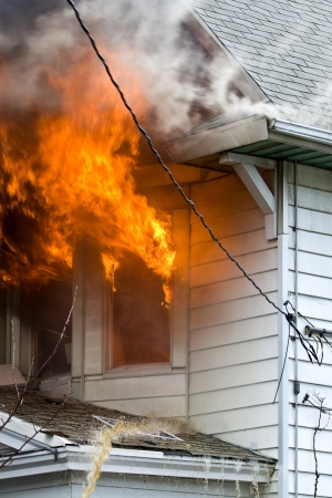 damages: Flames and smoke of a bad house fire