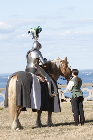 Medieval Knight with helper photo