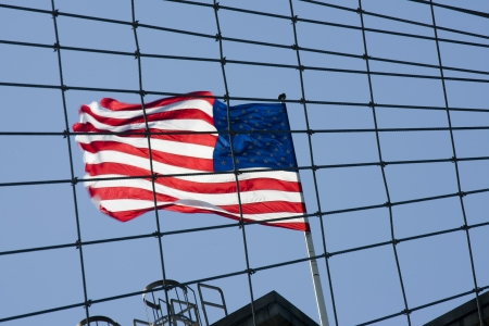 Flag of USA at Brooklyn bridge photo