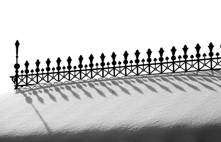 Decorative fence with shadow of it. photo