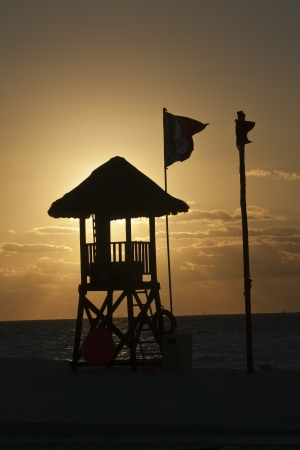 Empty lifeguard station at tropical Mexico beach photo