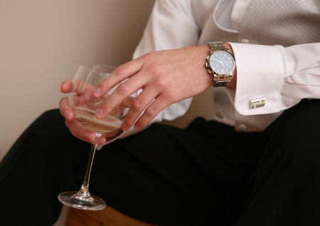 Groom gets glass of wine befor  wedding. photo
