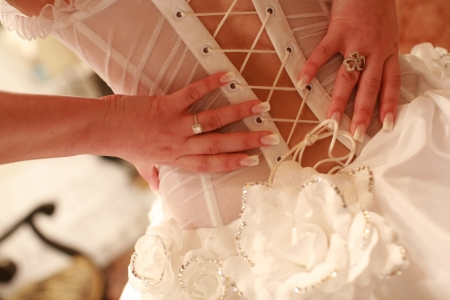 concave: Bride dressing for the wedding ceremony