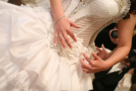 Bride dressing for the wedding ceremony  photo
