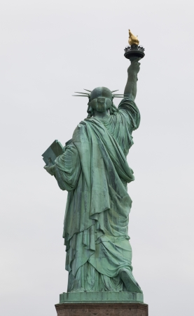 liberty torch: Statue of Liberty with a blue sky background. Stock Photo
