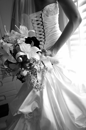 Bride dressing for the wedding ceremony