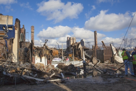 NEW YORK - October 31: Homes sit smoldering after Hurricane Sandy  in the Far Rockaway area . Over 50 homes were reportedly destroyed in a fire during the storm on October 30; 2012 in New York City; NY